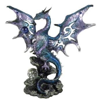 Figurine Dragon bleu ailes déployées sur tenant sur un rocher